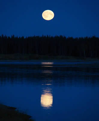Arctic Moon above the river